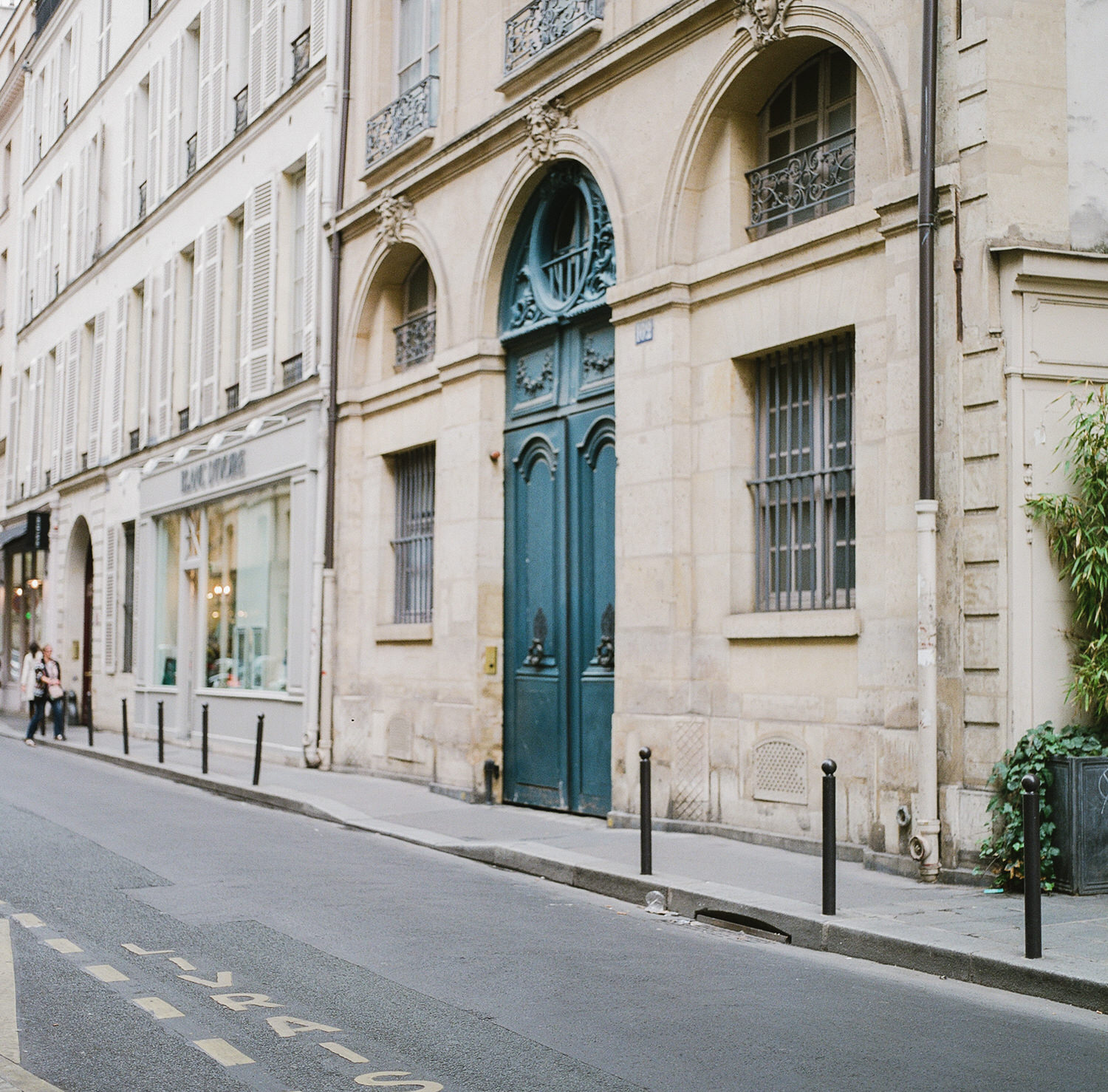 street in Paris France. Teal blue door. Photo by Judith Rae.